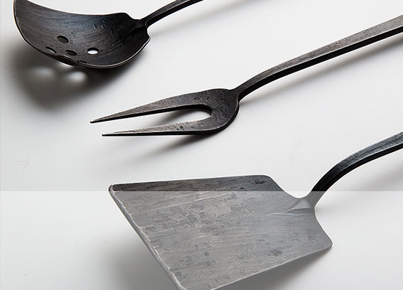 A 3pc hand-forged kithcen utensil set by Andrew Dohner. $385