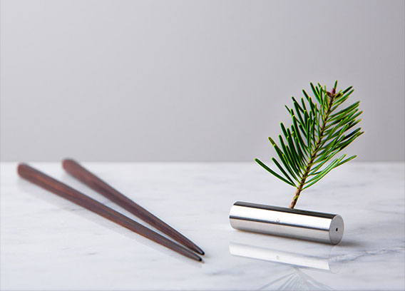 A unique Bud Vase / Chopstick Rest combination tool for the tabletop designed by Martin Kaster of Crucial Detail.