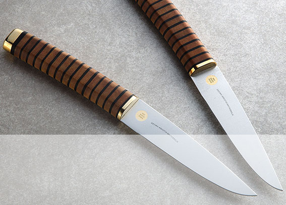 The Steak Knife, Pair - by Florentine Kitchen Knives, in tauari wood, leather and brass. $235 per pair.