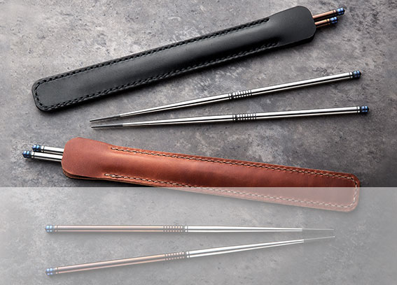 TiStix two-tone Limited Edition Titanium Chopsticks pictured with One start Leather chopsticks cases.